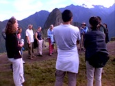 Stock Video Footage of Wide-shot of tourists looking at Inca ruins of Machu Picchu in Peru.