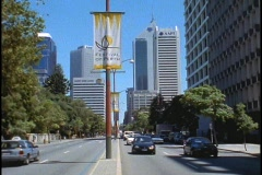 A Festival of Perth sign hangs from a light post as traffic drives by. Stock Footage