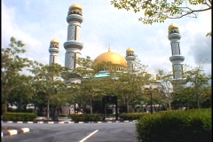 A palace with gold domes stands in Brunei, Borneo. Stock Footage