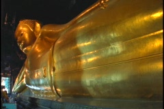 A golden Buddha statue sits in a temple in Bangkok, Thailand. Stock Footage