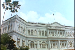 The Raffles Hotel in Singapore displays its colonial architecture. Stock Footage
