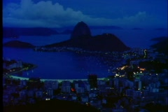 Corcovado mountain is silhouetted against the ocean overlooking Rio De Janeiro, Stock Footage