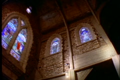 Stained glass windows adorn the interior of a Catholic church. Stock Footage