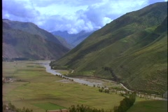 Farmland stretches across a fertile valley in Peru. Stock Footage