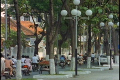 Traffic drives down a busy street in Ho Chi Minh City, Vietnam. Stock Footage