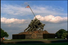 A flag ruffles in the breeze on top of the Marine Corps Memorial statue near Stock Footage