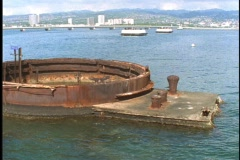 The top of a large rusty tank sits open above the oceans surface at the USS Stock Footage
