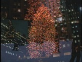 Ice skaters circle Rockefeller Center. Stock Footage