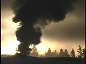 Smoke spews from a geothermal feature in Yellowstone National Park. Stock Footage