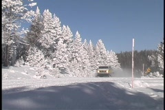 A van drives down a snow covered road. Stock Footage