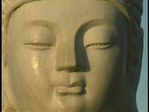 Light shines on a Buddha statue. Stock Footage