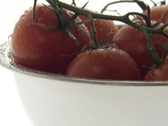 Water droplets drip down cherry tomatoes in a bowl. Stock Footage