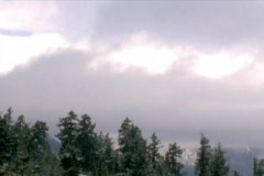 Clouds drift over the Sierra Nevada mountains. Stock Footage