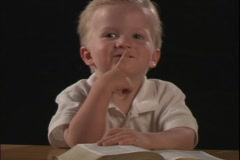 A little boy reads the Bible. Stock Footage