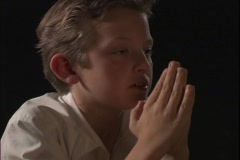 A young boy prays. Stock Footage