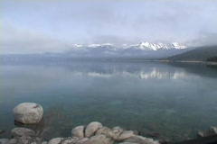 Fog covers a lake over a misty morning dawn at Lake Tahoe, Nevada. Stock Footage