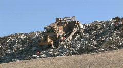Bull Dozer trash dump M HD - stock footage