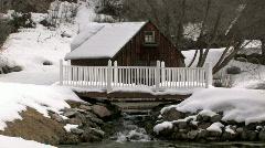Cabin waterfall bird in winter M HD Stock Footage