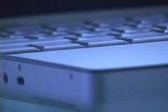 The base of a laptop computer is closely inspected. Stock Footage