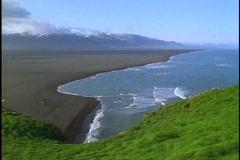 Black sand lines the coastline of Iceland. Stock Footage