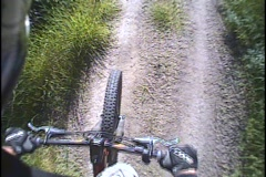 A mountain bike rides over a trail. Stock Footage