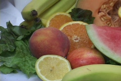 A fruit display includes watermelons and bananas. Stock Footage