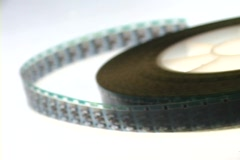 Selective-focus of an unrolled spool of film. Stock Footage