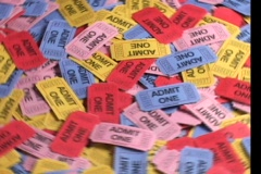 A bird's-eye view of colorful batch of rotating tickets. Stock Footage