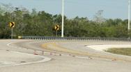 Car traveling through big curve Stock Footage