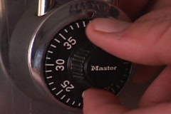 A person turns a combination lock. Stock Footage