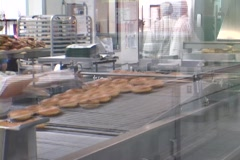 A time-lapse look at a donut shop with workers and donuts moving fast. Stock Footage