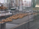 Stock Video Footage of A time-lapse look at a donut shop with workers and donuts moving fast.