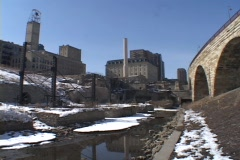 A look at an urban canal in winter with old factories in the background. Stock Footage