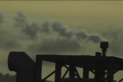 Steam emits from the top of a piece of heavy equipment at golden-hour. Stock Footage