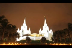 Clouds pass over the twin spires of the LDS temple in San Diego, California. Stock Footage