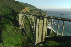 A bridge over rugged coastal terrain makes traveling easier. Stock Footage