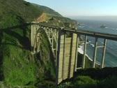 A bridge over rugged coastal terrain makes traveling easier. Stock Footage