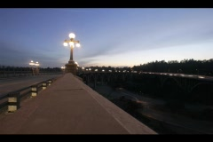 A time-lapse shot of a freeway median, street-lights, and traffic at golden Stock Footage