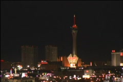 A jet soars past the lit up Las Vegas skyline. Stock Footage
