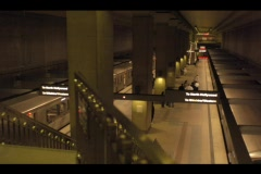 People and trains arrive and depart from an underground station in this Stock Footage