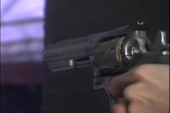 A man fires a revolver. Stock Footage