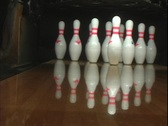 A blue bowling ball rolls down the lane knocking over nine pins. Stock Footage