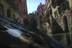 A water taxi cruises through water canals in Venice, Italy. Stock Footage
