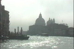 A water-taxi floats down the Grand Canal towards St. Mark's Square in Venice, Stock Footage