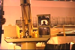 A large crane sits empty in a factory. Stock Footage