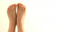Bare Feet Enter Bottom Frame - stock footage