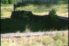 Following shot of a Rio Grande steam freight train traveling through a Colorado - stock footage