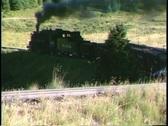 Following shot of a Rio Grande steam freight train traveling through a Colorado Stock Footage