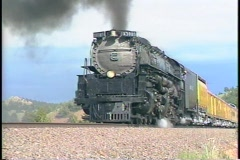 Tracking-left shot of a Union Pacific steam passenger train. Stock Footage