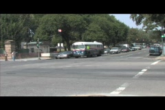 A Veterans for Peace bus crosses an intersection in Washington DC Stock Footage